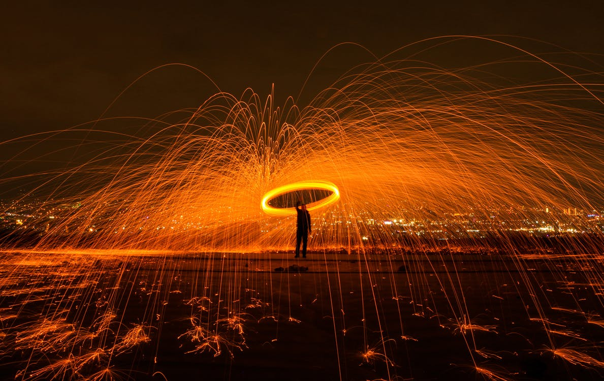 Man and fireworks at night - Brisbane is burning on samuelpavin.com